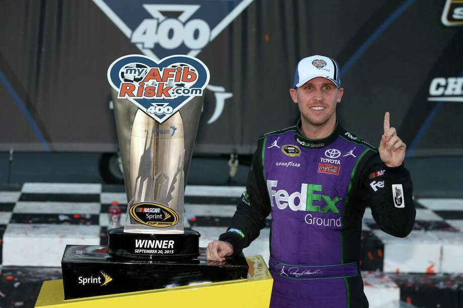 JOLIET, IL - SEPTEMBER 20:  Denny Hamlin, driver of the #11 FedEx Ground Toyota, poses with the myAFibRisk.com 400 trophy after winning the NASCAR Sprint Cup Series myAFibRisk.com 400 at Chicagoland Speedway on September 20, 2015 in Joliet, Illinois.  (Photo by Sean Gardner/Getty Images) ORG XMIT: 578572763 Photo: Sean Gardner / 2015 Getty Images