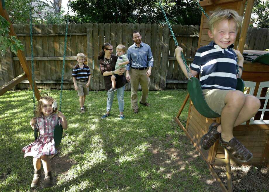 Some of the Regitz family of Tomball - Anna Tess, 4, from left, Athan, 9, mom Stephanie with Kieran, 2, dad Matt Regitz, and Becket, 6 - will travel to Philadelphia to see Pope Francis this coming weekend.  Photo: Melissa Phillip, Staff / © 2015 Houston Chronicle