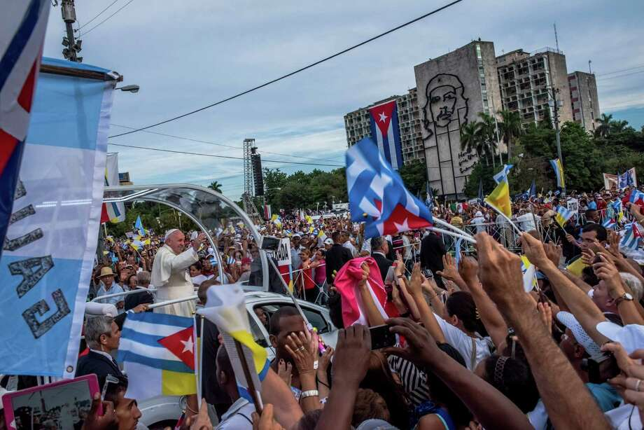 Enthusiastic crowds greet Pope Francis as he arrives for Mass at the Plaza of the Revolution. Photo: DANIEL BEREHULAK, STR / NYTNS