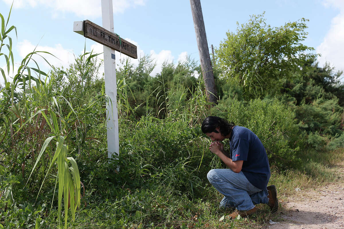 Iraq War veteran Sabastian Vasquez, pays his respect at a memorial for family friend and parish priest, Tim Kinast, on Aug. 6 by the Austwell Pier near Tivoli. Vasquez made three tours and was diagnosed with Post-Traumatic Stress Disorder.