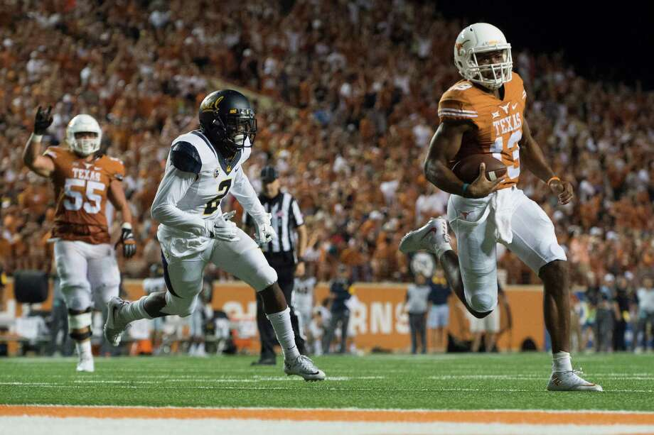 Jerrod Heard's 527 yards of total offense on Saturday night put him in the UT record book in only the second start of his career. Photo: Cooper Neill, Stringer / 2015 Getty Images