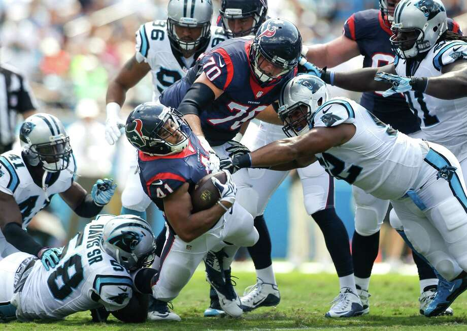 Texans running back Jonathan Grimes (41) is tackled by Panthers linebacker Thomas Davis, lower left. Grimes carried twice for 7 yards. Photo: Brett Coomer, Staff / © 2015  Houston Chronicle