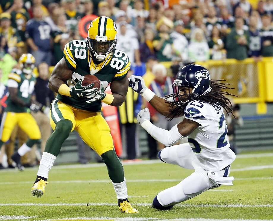 Green Bay's James Jones catches a touchdown pass in front of Seattle's Richard Sherman. Photo: Mike Roemer, Associated Press