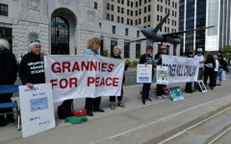 A group calling themselves Grannies for Peace demonstrate in the west park of the Capitol Wednesday afternoon, Sept. 17, 2014, in Albany, N.Y., to demand an end to the CIA and US military drone strikes. (Skip Dickstein/Times Union) Photo: SKIP DICKSTEIN / 00028633A
