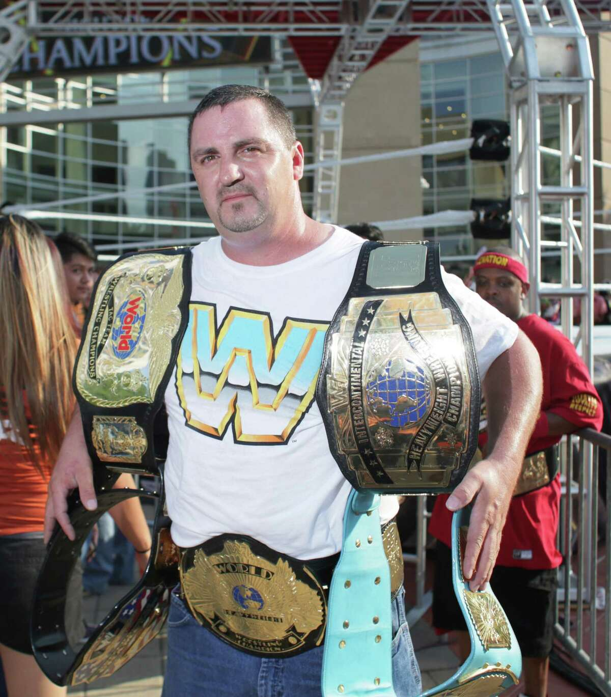 Fans pose for a photo before the WWE Night of Champions at the Toyota Center, Sunday, September 20, in Houston, Texas.