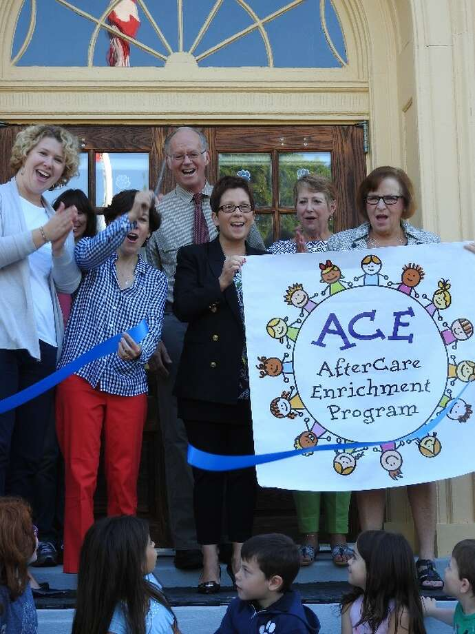 The AfterCare Enrichment Program (ACE) is launched Sept. 18 with L to R: Carolan Dwyer, founder; Brienne Leslie, assistant director; Lanie Flanagan, director; Curtis Read, first selectman; Cathy Colella, principal; Susan Niesobecki, advisory committee; and Pat Cosentino, Superintendent of Schools. Photo: / Contributed Photo