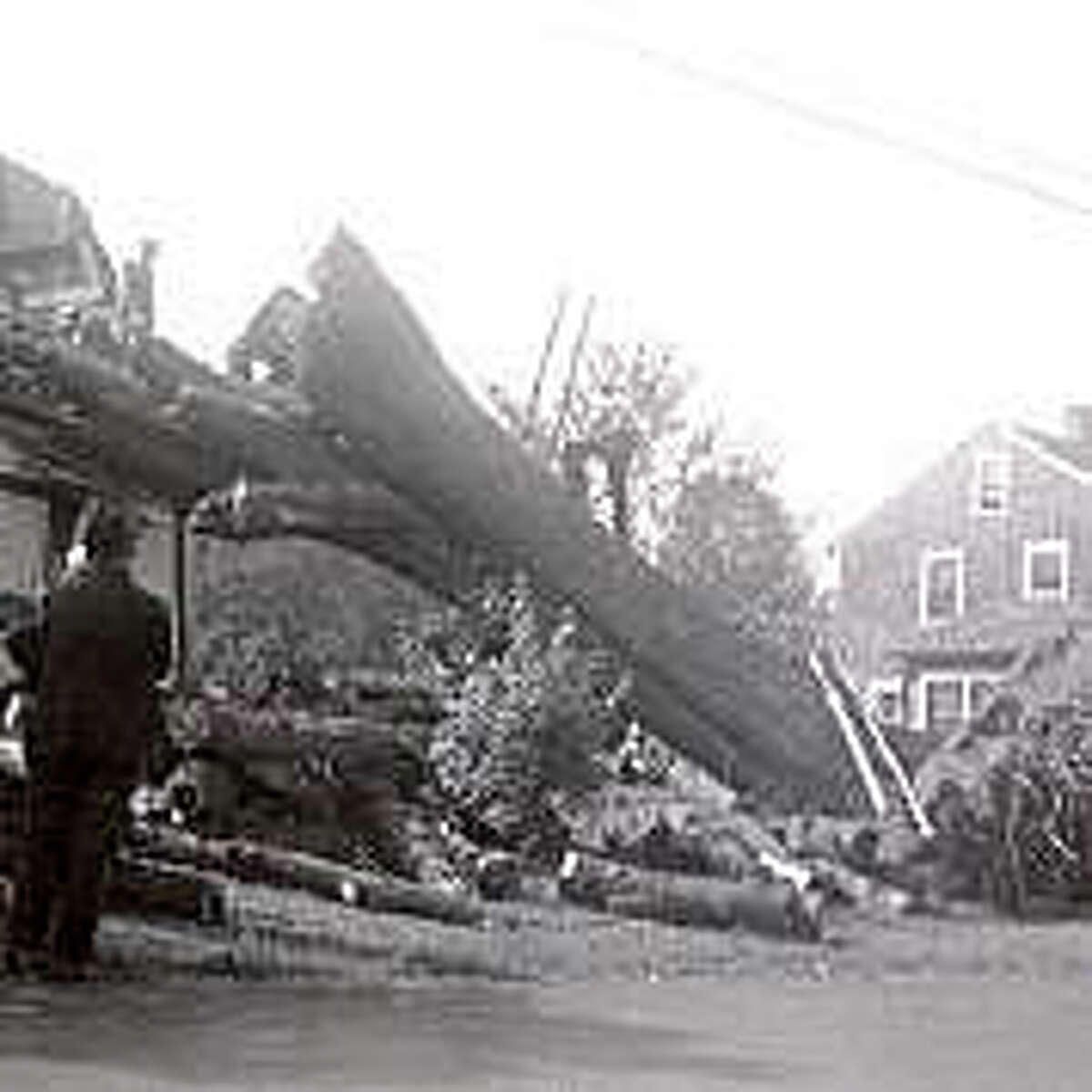 Fairfield residents work together to remove a tree that crashed onto a house during the Hurricane of 1938. Courtesy: Fairfield Museum and History Center.