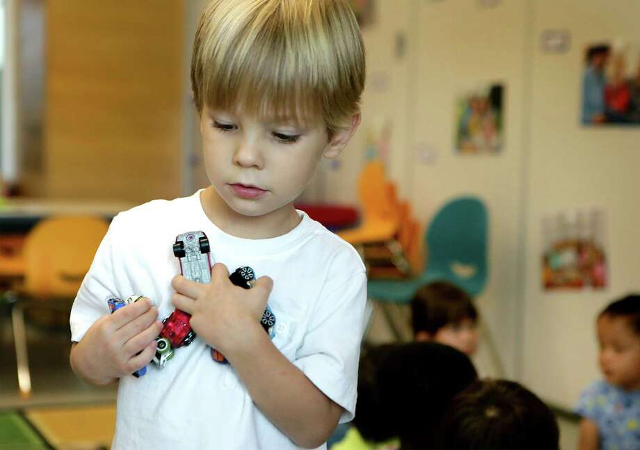 Harris Meabon carries a load of toy cars as he plays in the Little Doers program.  Kids in the Little Doers program at the DoSeum get to play while learning in the popular new kids spot on Broadway, on Wednesday, Sept. 16, 2015. Photo: BOB OWEN, Staff / San Antonio Express-News / San Antonio Express-News
