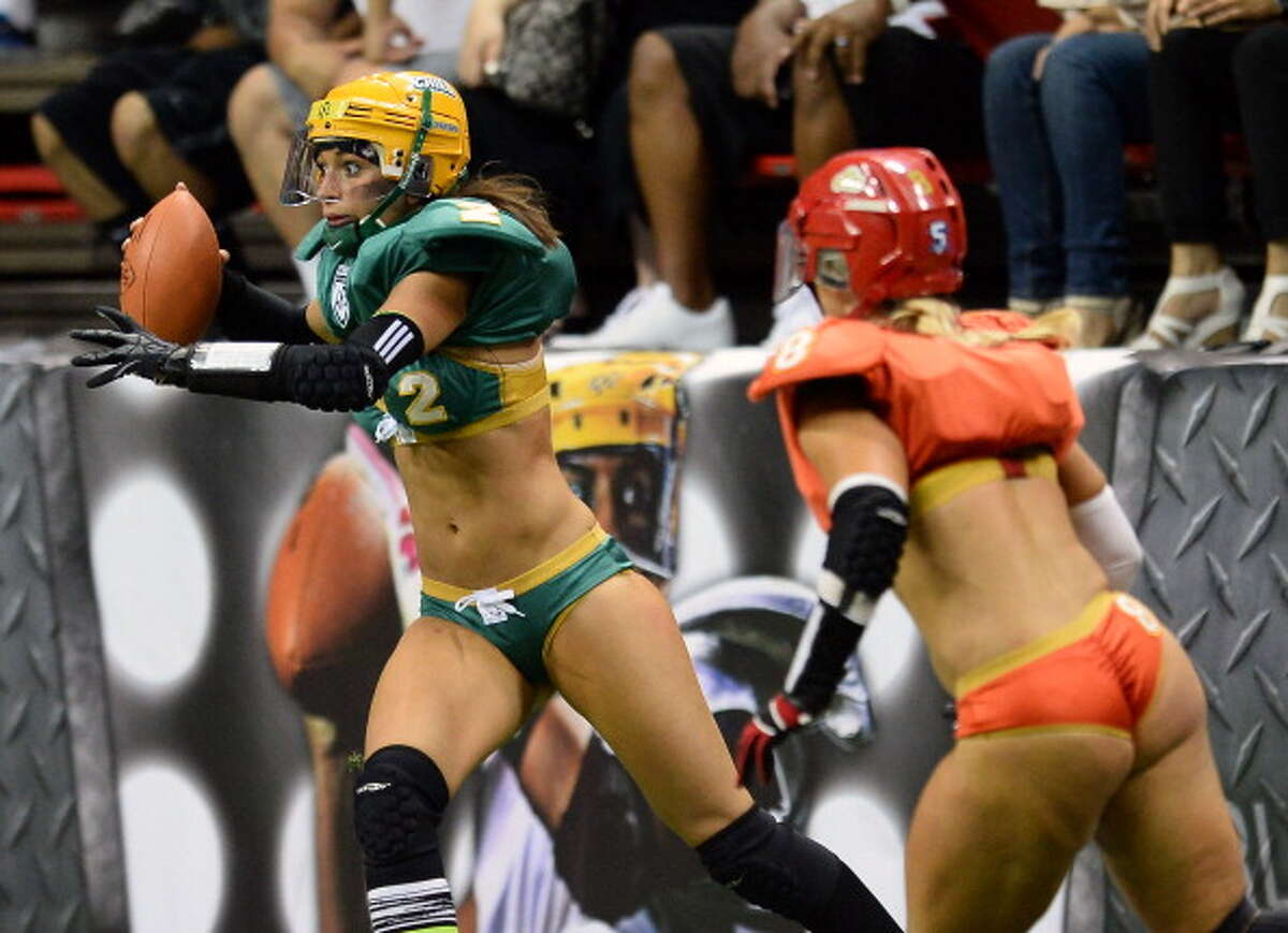 LAS VEGAS, NV - MAY 15: Quarterback Jessica Peyton #2 of the Green Bay Chill scrambles under pressure from Danika Brace #8 of the Las Vegas Sin during their game at the Thomas & Mack Center on May 15, 2014 in Las Vegas, Nevada. Las Vegas won 34-24.