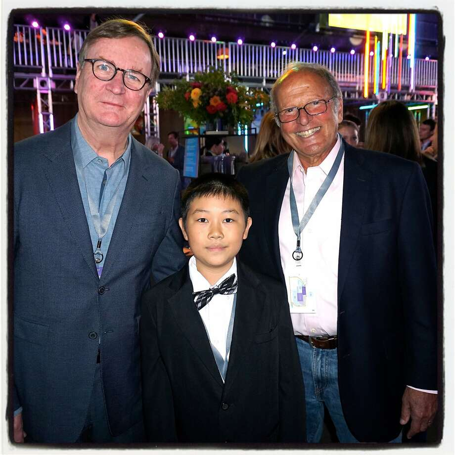 UCSF Chancellor, Dr. Sam Hawgood (left) with former patient, Zhenkang Zhao, and UCSF Benioff Children's Hospital Oakland CEO, Dr. Bert Lubin at Pier 70 during Dreamforce Concert for the Kids. Sept 2015. Photo: Catherine Bigelow, Special To The Chronicle