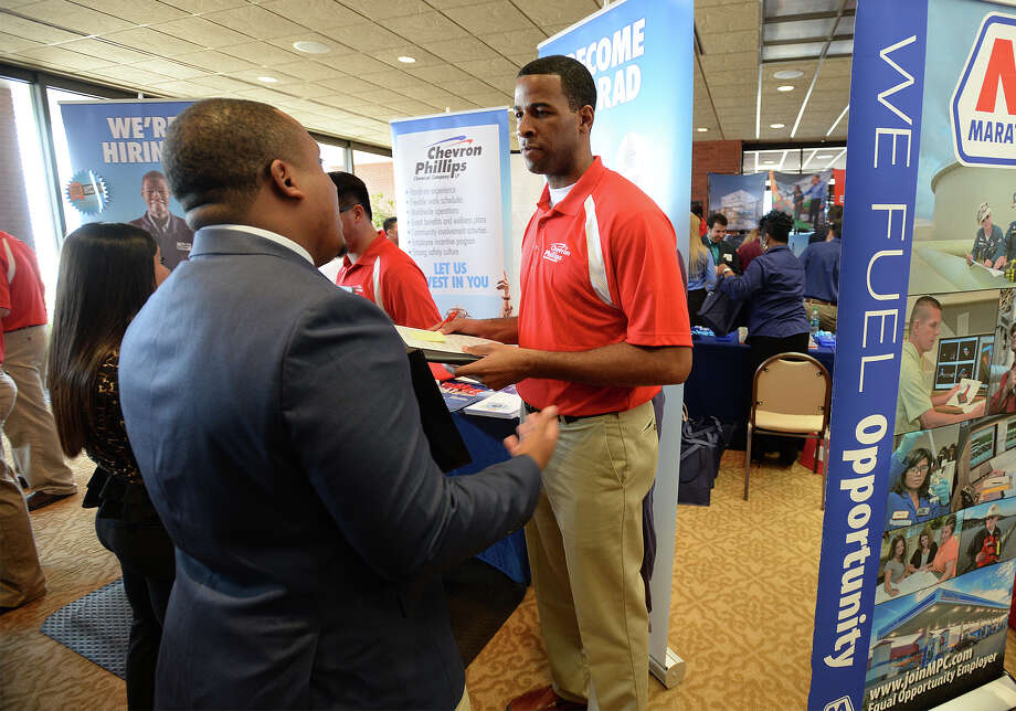 Bryan Hunter, right, with Chevron Phillips talks to Joshua Wilson at Lamar's job fair for students on Thursday. Photo taken Thursday, September 17, 2015 Guiseppe Barranco/The Enterprise Photo: Guiseppe Barranco, Photo Editor