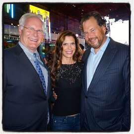 UCSF Benioff Children's Hospital CEO Mark Laret (left) with Lynne Benioff and her husband, Salesforce founder Marc Benioff, at Pier 70 for Dreamforce Concert for the Kids. Sept 2015.