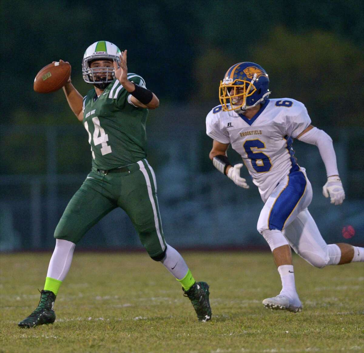 A week after having his way with the Brookfield defense, New Milford's Tyler Hansen was at it again on the road against Bunnell in the Green Wave's first win of the season, 35-21. A dual threat with his arm and his legs, the senior senior-caller threw three touchdowns and ran for two more to bring his three-game all-purpose touchdown total to 10, and his latest performance gave the Green Wave their first win over the Bulldogs since 2001.