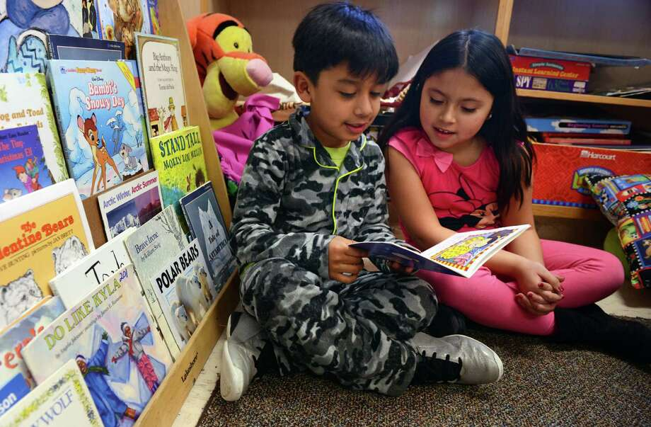 Second-grade students Nicholas Mendoza and Maileen Rojas-Altamirano read together during at Madison Elementary School in Bridgeport, Conn. Photo: Autumn Driscoll / Autumn Driscoll / Connecticut Post