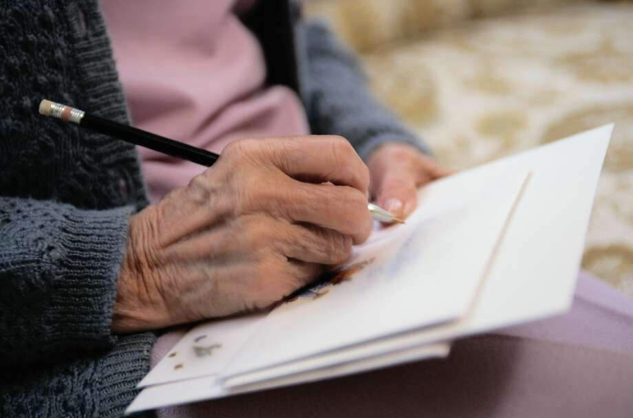 An older lady wants to send letters to friends to let them know how much they mean to her. Photo: Keith Brofsky