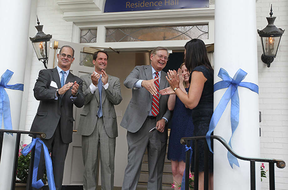 The Beacon School, Stamford's first school for gifted education, recently celebrated its opening in the city. Pictured, from left, Eric Kaye, chairman of the Greenwich Education Group's School Foundation; U.S. Rep. Jim Himes, Mayor David Martin and Victoria Newman, founder and executive director, Greenwich Education Group. Photo: Contributed Photo / Stamford Advocate Contributed