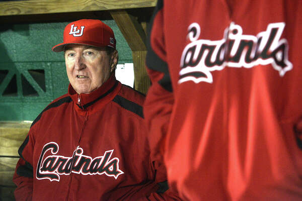 Lamar's head coach Jim Gilligan takes in the action from the dugout during the Cardinals' home opener against New Mexico State Friday night at Vincent Beck Stadium. Photo taken Friday, February 13, 2015 Kim Brent/The Enterprise