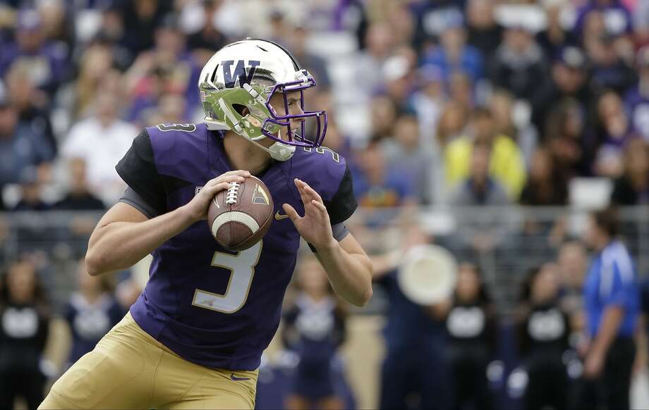 Washington quarterback Jake Browning looks to pass during the Huskies' win Saturday over Utah State. (AP Photo/Ted S. Warren) Photo: Ted S. Warren, Associated Press