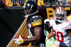 Pittsburgh Steelers wide receiver Antonio Brown (84) smiles after making a touchdown catch past San Francisco 49ers cornerback Kenneth Acker (20) in an NFL football game, Sunday, Sept. 20, 2015, in Pittsburgh. (AP Photo/Gene J. Puskar)