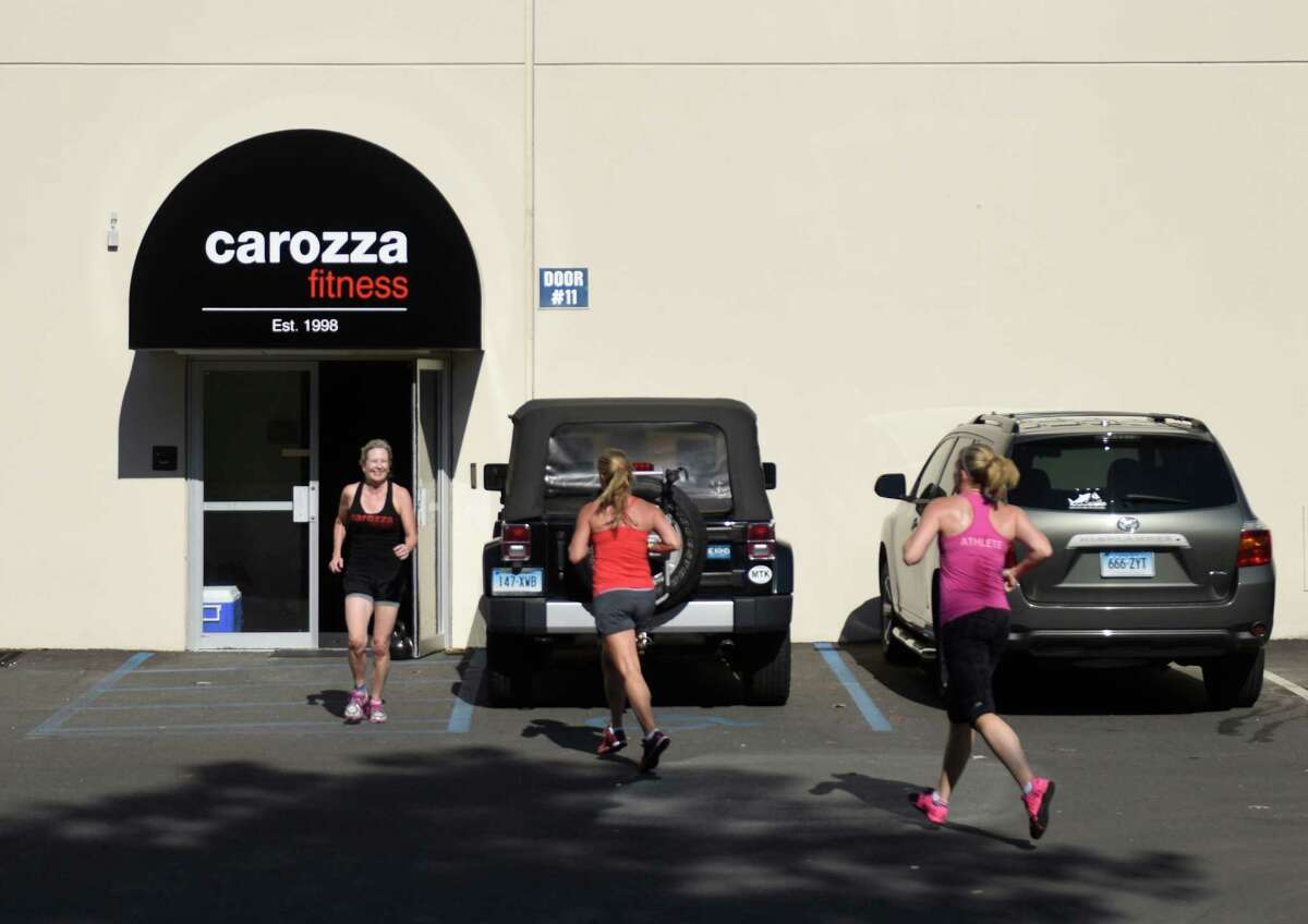 Carozza Fitness - StamfordWebsite Pictured: Class participants do a 400 meter outdoor run during a CrossFit class at Carozza Fitness in Stamford, Conn. Thursday, Sept. 17, 2015. The CrossFit facility relocated into the 10,000 sq. ft. space at 316 Courtland Ave. in Stamford from its former quarters on the west side of town.