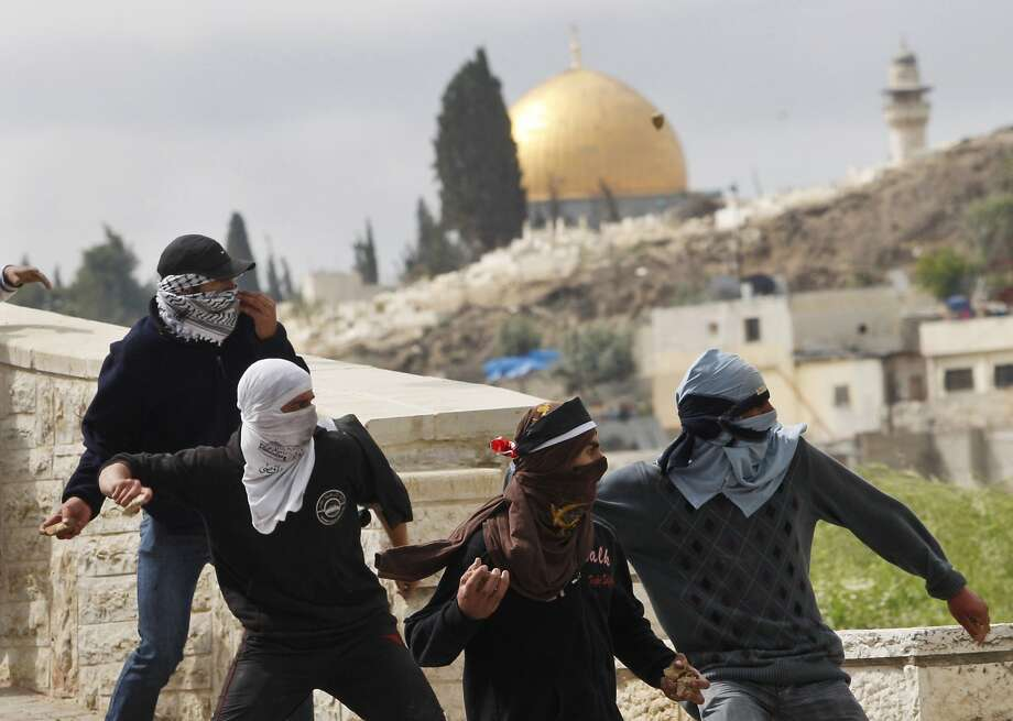 Palestinian demonstrators hurl stones in 2010 at Israeli troops in East Jerusalem. Tech-savvy Israel is struggling with the resurgence of a weapon dating back to David and Goliath. Photo: Dan Balilty, Associated Press