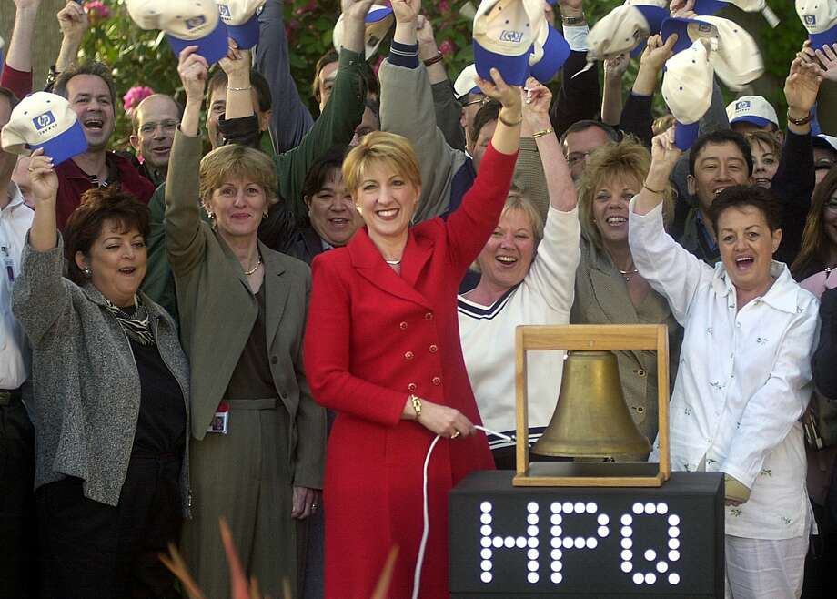 Then-Hewlett Packard CEO Carly Fiorina rang a bell to virtually open the New York Stock Exchange from HP headquarters. Photo: Chris Preovolos, Associated Press