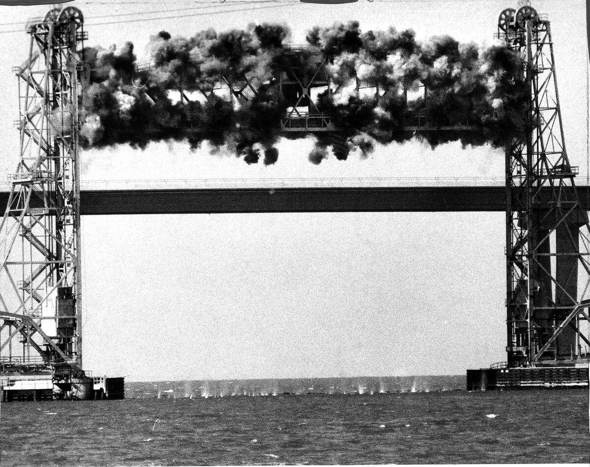 Using explosives to demolish the Drawbridge portion of the Dumbarton Bridge in the South Bay 1 of a 3 photo series .. Photo ran 09/24/1984, p. 2