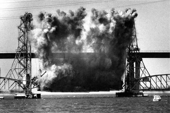 Using explosives to demolish the Drawbridge portion of the Dumbarton Bridge in the South Bay   Photo ran 09/24/1984, p. 1