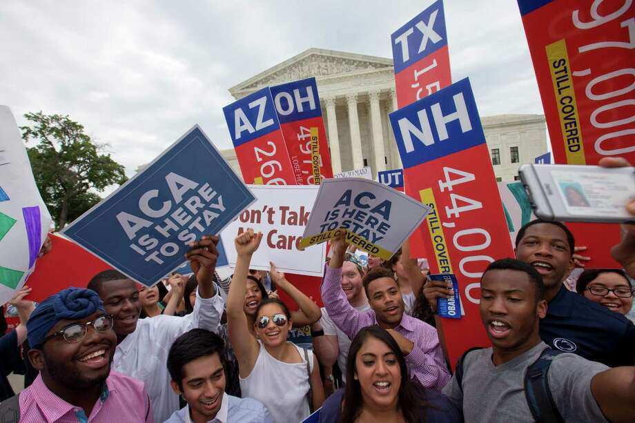 FILE - In this June 25, 2015 file photo, demonstrators cheer as they hold up signs stating outside the Supreme Court in Washington after the court decided that the without the Affordable Care Act (ACA) may provide nationwide tax subsidies. A federal appeals court ruled Friday that the Supreme Court can keep protesters off its marble plaza without violating their constitutional right to free speech. The U.S. Court of Appeals for the District of Columbia Circuit said that First Amendment rights stop at the sidewalk in front of the majestic courthouse and do not extend to the plaza. (AP Photo/Jacquelyn Martin, File) Photo: Jacquelyn Martin, STF / AP