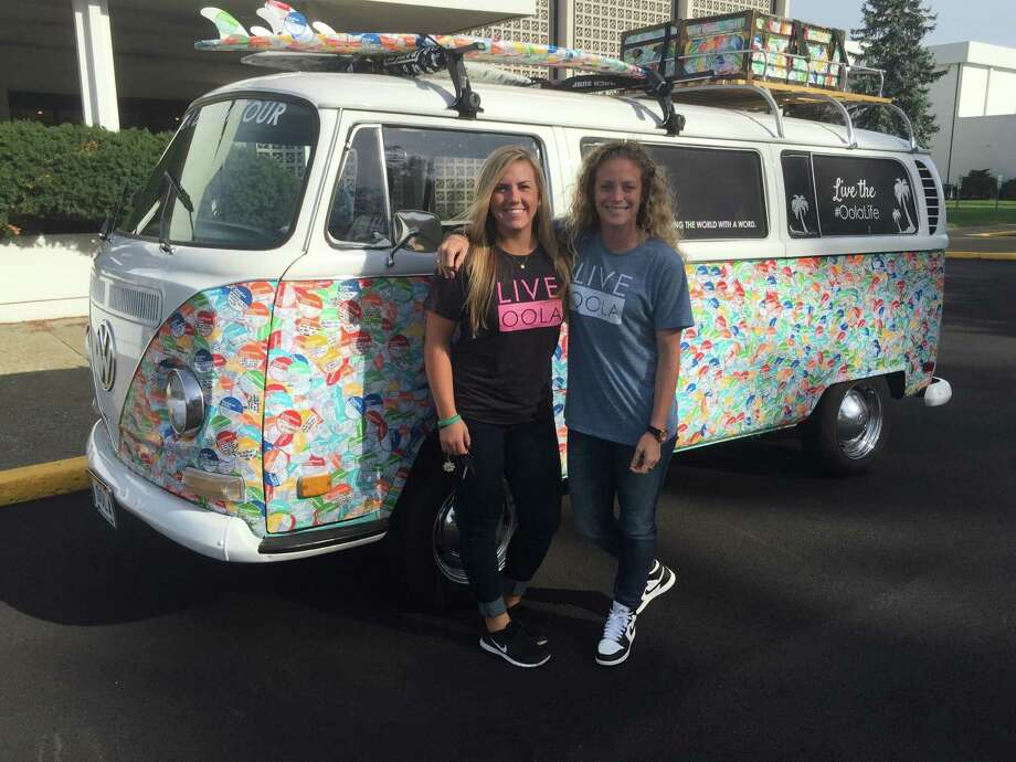 "Taylor Laguardia, left, and Annie Hawkins bring the Oola Dream Tour VW bus to the Capital Region on Monday, Sept. 21, 2015, to promote living ""the life of your dreams."" More than 4,000 people have affixed stickers to the bus affirming the change they'd like to make during the coming year. Photo: Paul Block / Times Union"