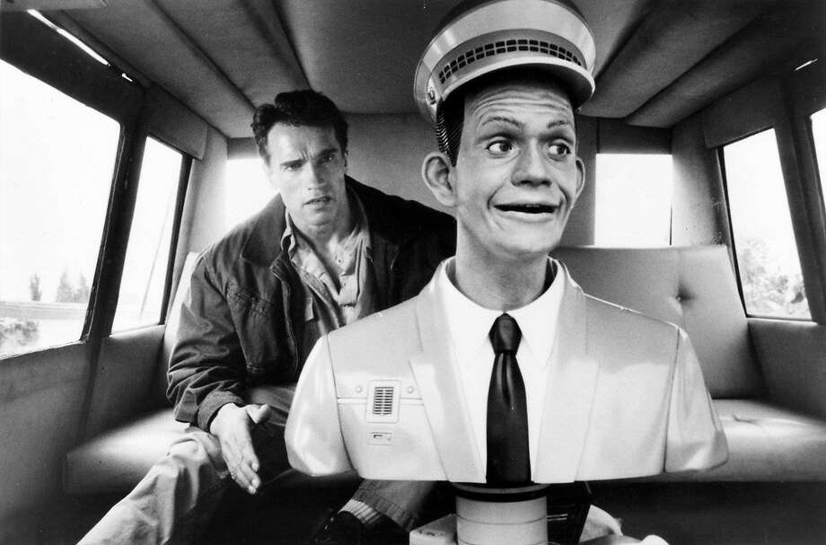"Quaid (Arnold Schwarzenegger) finds himself in a robot driven Johnny-Cab in a scene from the movie ""Total Recall."" Photo: Handout, SFC"