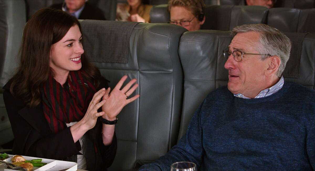 This photo provided by Warner Bros. Pictures shows, Anne Hathaway, left, as Jules Ostin, and Robert De Niro as Ben Whittaker scene from the comedy,