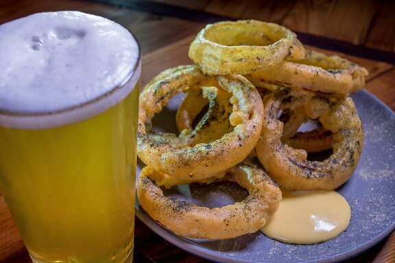 The beer battered Onion Rings with a beer at the Starline Social Club in Oakland, Calif., are seen on September 20th, 2015.