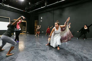 """Guest artist instructor S.T. Shimi (left) leads the cast in warm up excercises during a rehearsal for a multimedia stage production for Hispanic Heritage Month called """"Napako (Our Journey)"""","""" at SAY Si, 1518 S. Alamo St., on Thursday, Sept. 18, 2015.  The play is about the story of the Blue Hole and the indigenous history of water in San Antonio.  MARVIN PFEIFFER/ mpfeiffer@express-news.net"""