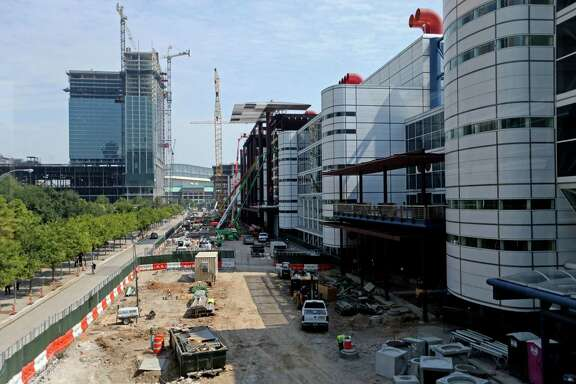 A street in front of the George R. Brown Convention Center is going from six lanes to two. Buses will go on either side of the building.