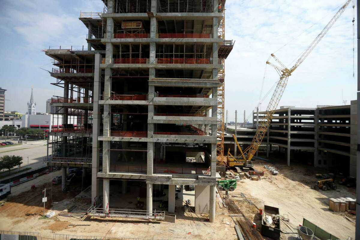 The Partnership Tower next to a 1900 car parking garage, Marriott Marquis and convention center parking, adjacent to the George R. Brown Convention Center Monday, Sept. 21, 2015, in Houston, Texas. Houston First Corporation (HFC) hosted a media tour highlighting ongoing renovations of the George R. Brown Convention Center (GRB), Avenida De Las Americas (ADLA), the new parking garage/office tower and the Marriott Marquis ( Gary Coronado / Houston Chronicle )