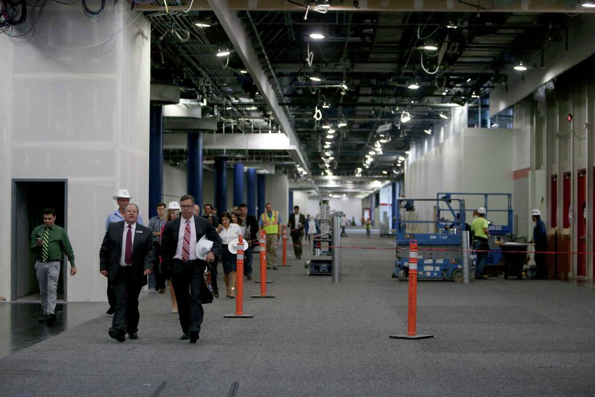 Dave Osterhout , second from left, director of operations, of Houston First Corporation, gives a tour of the Exhibition Concourse under renovation at the George R. Brown Convention Center Monday, Sept. 21, 2015, in Houston, Texas. Houston First Corporation (HFC) hosted a media tour highlighting ongoing renovations of the George R. Brown Convention Center (GRB), Avenida De Las Americas (ADLA), the new parking garage/office tower and the Marriott Marquis ( Gary Coronado / Houston Chronicle )
