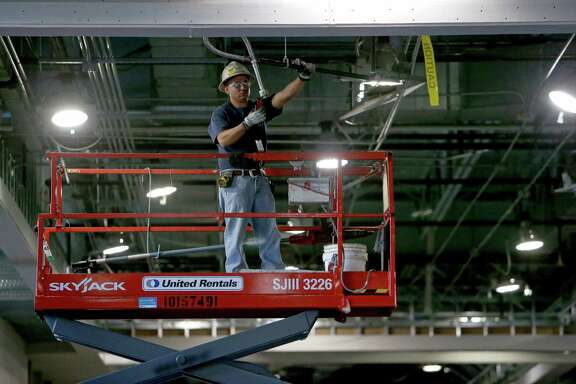 Workers put the finishing touches to the Exhibition Concourse of the George R. Brown Convention Center Monday, Sept. 21, 2015, in Houston, Texas. Houston First Corporation (HFC) hosted a media tour highlighting ongoing renovations of the George R. Brown Convention Center (GRB), Avenida De Las Americas (ADLA), the new parking garage/office tower and the Marriott Marquis  ( Gary Coronado / Houston Chronicle )
