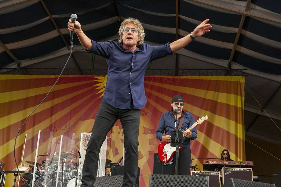 """FILE - In this April 25, 2015 file photo, Roger Daltrey and Pete Townshend perform with The Who at the New Orleans Jazz & Heritage Festival, in New Orleans. The band announced Friday, Sept. 18, 2015, that it was postponing all 50 dates of """"The Who Hits 50"""" tour this fall because lead singer Daltrey has contracted viral meningitis. He's feeling better, but says he's under doctors' orders to rest. (Photo by Barry Brecheisen/Invision/AP, File) Photo: Barry Brecheisen, Associated Press"""