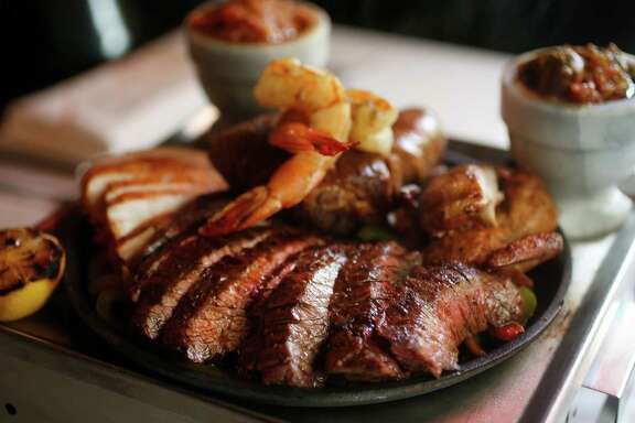 Parrillada Clasico, with Anejo beef and chicken fajitas, wild boar carnitas, Black Hill Ranch sausage, Texas Hill Country quail, Gulf Coast shrimp, and chili bacon, photographed at Anejo on Thursday, Sept. 17, 2015.  ( Karen Warren / Houston Chronicle )