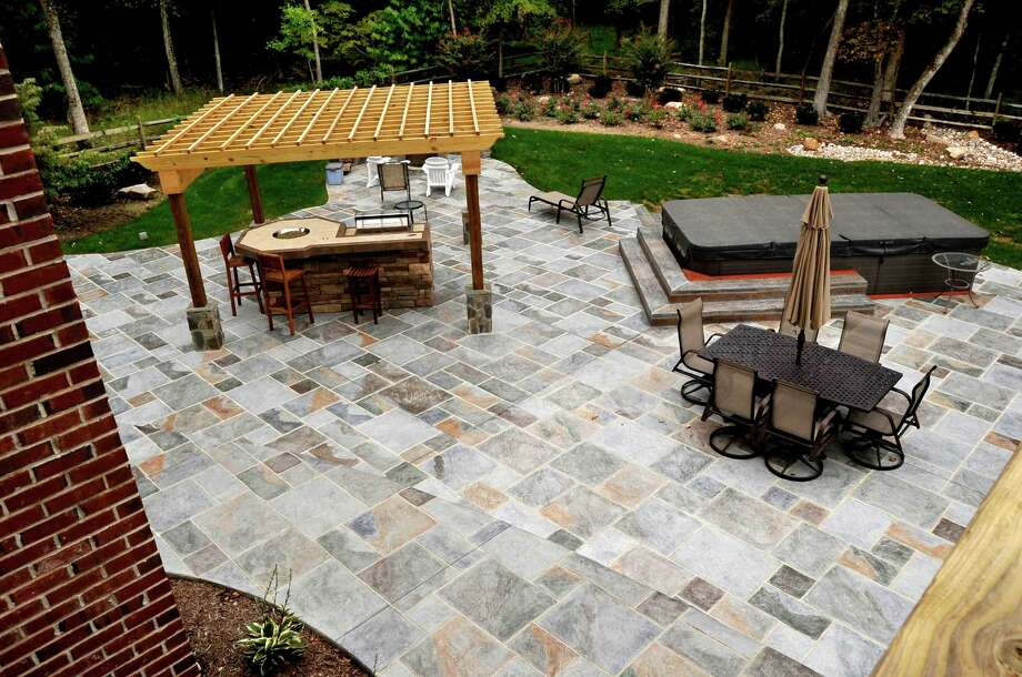 Concrete can be custom-stained with different colors to look like stone. This patio, designed by Salzano Custom Concrete, has been treated with a selection of several stains.