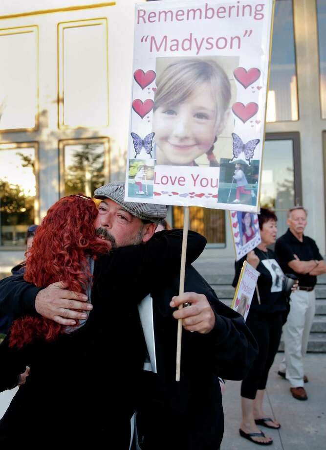 "Michael Middleton, whose daughter Madyson ""Maddy"" Middleton was killed, hugs friend Misty Tam outside the Santa Cruz courthouse, where defendant Adrian Jerry Gonzalez was arraigned. Photo: Connor Radnovich / Connor Radnovich / The Chronicle / ONLINE_YES"