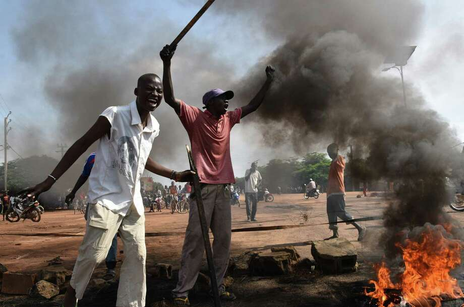 Demonstrators in Ouagadougou burn tires in protest of a regional proposal to end the crisis in Burkina Faso on Monday, five days after a military coup. Photo: SIA KAMBOU, Stringer / AFP