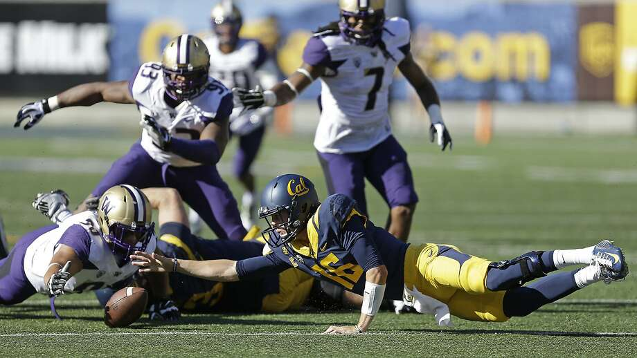 Cal quarterback Jared Goff (16) reaches for a fumble that was recovered by Washington's Taniela Tupou (90) during the first half of the Bears' 31-7 loss to the Huskies last October. Photo: Ben Margot, Associated Press