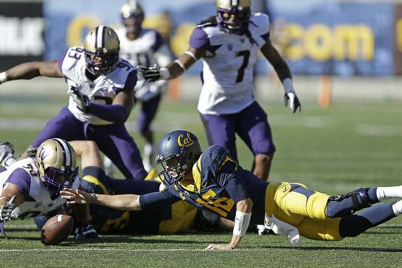 Cal quarterback Jared Goff (16) reaches for a fumble that was recovered by Washington's Taniela Tupou (90) during the first half of the Bears' 31-7 loss to the Huskies last October.