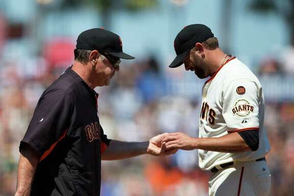 SAN FRANCISCO, CA - JUNE 25:  Jeremy Affeldt #41 of the San Francisco Giants is relieved by manager Bruce Bochy #15 during the eighth inning against the San Diego Padres at AT&T Park on June 25, 2015 in San Francisco, California.  The San Francisco Giants defeated the San Diego Padres 13-8. (Photo by Jason O. Watson/Getty Images)