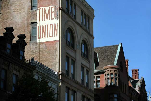 A Times Union sign is brought back to life at 58 N. Pearl St. on Tuesday, Sept. 15, 2015,  in Albany, N.Y. (Cindy Schultz / Times Union) Photo: Cindy Schultz / 00033370A