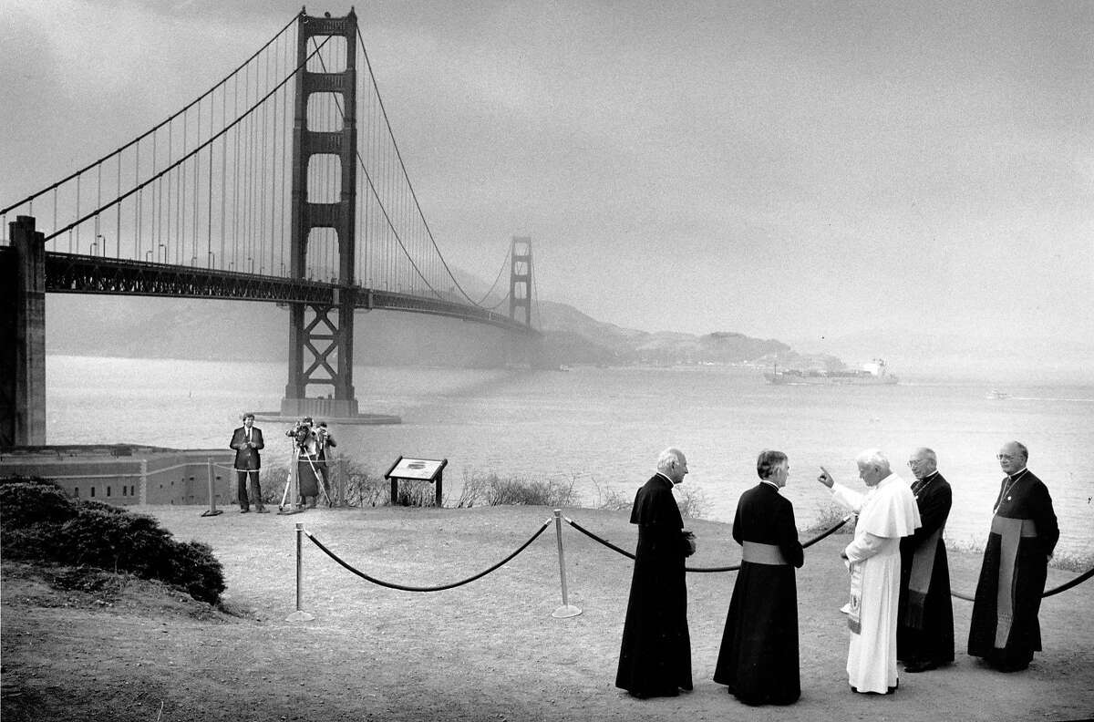 Pope John Paul II with archbishop John Quinn (to his left) within view of the Golden Gate Bridge on Sept. 18, 1987.
