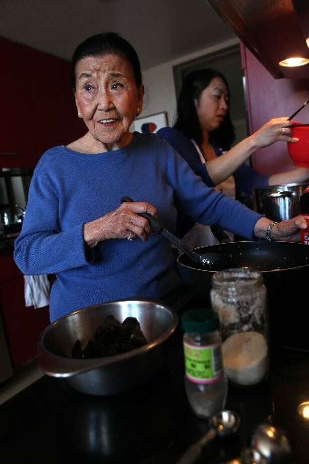 Cecilia Chiang cooking.
