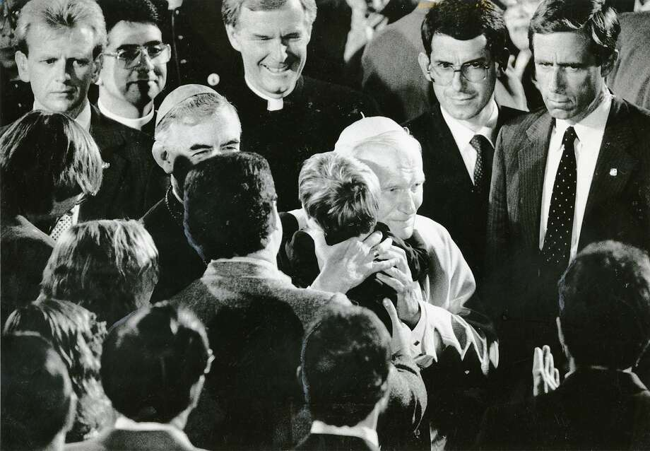 The Pope hugs 4-year-old AIDS victim Brendan O'Rourke at Mission Dolores in San Francisco on Sept. 17, 1987. Photo: Eric Luse, The Chronicle